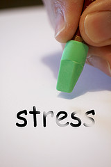 "word ""stress"" written with a pen"